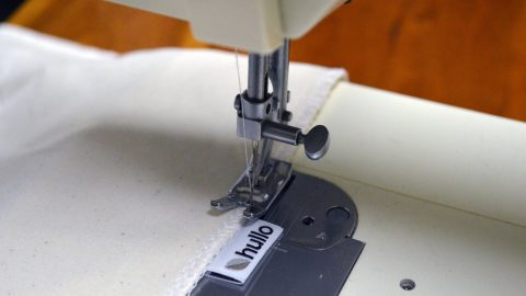 A Hullo pillow case being sewn