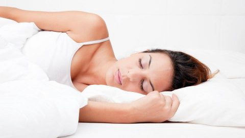 Woman sleeping soundly on a buckwheat pillow