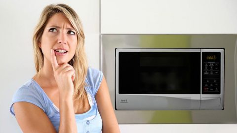 Woman contemplates microwaving things