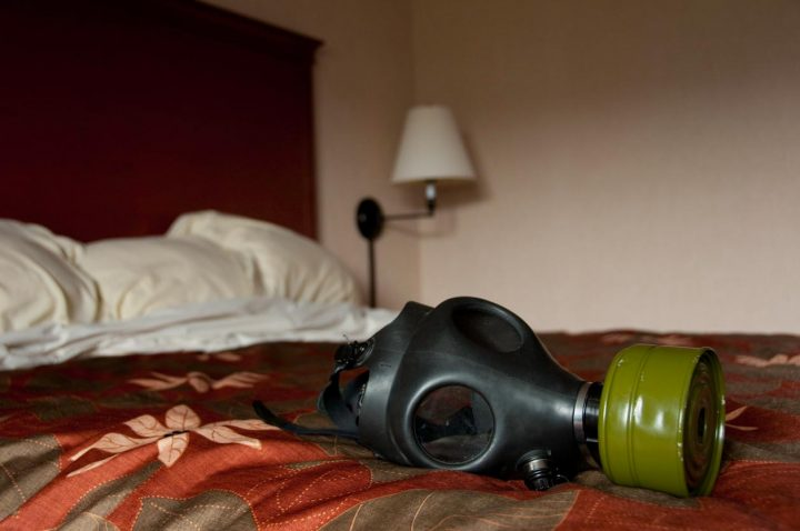 A gas mask sits on a memory foam mattress